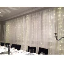 Chiffon draping fairy lighting curtain hire